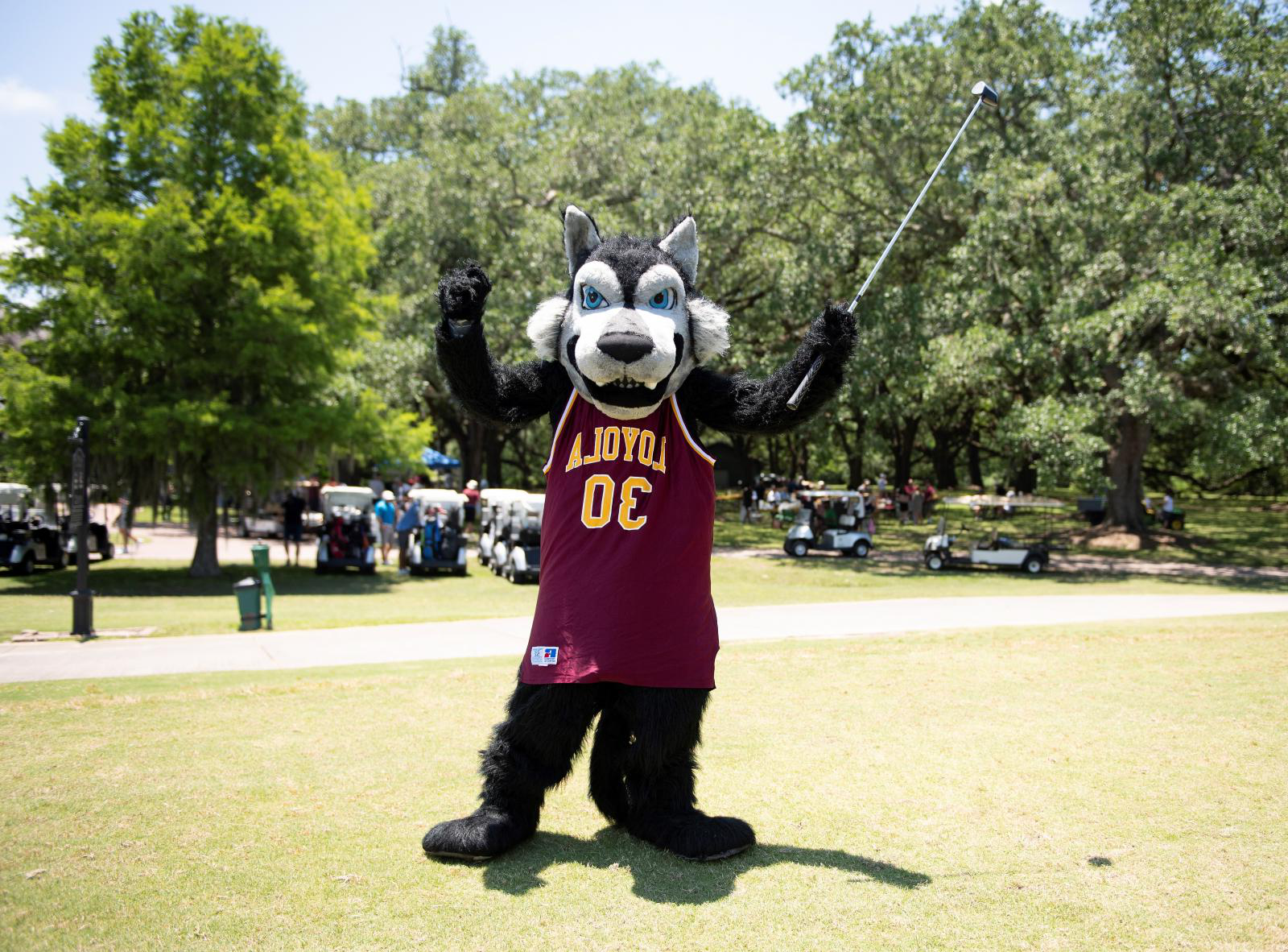 Photo of Loyola mascot golfing